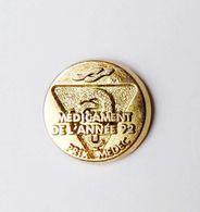 Pin's Doré Médicament De L'année 92 Prix Medec - 18A - Badges