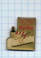 Pin's Pins /  THEME JEUX OLYMPIQUE -  SKI SPONSOR KODAK PHOTOGRAPHIE - Jeux Olympiques