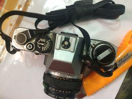APPAREIL PHOTO D'OCCASION -OLYMPUS OM 10. - Appareils Photo