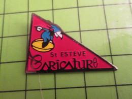 818b Pin's Pins / Rare Et De Belle Qualité / THEME SPORTS / RUGBY BALLON OVALE ST ESTEVE CARICATURE - Rugby