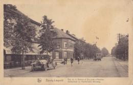 Bourg-Léopold Rue De La Station Et Chaussée D'Hechtel Avec Le Grand Hôtel Cambrinus à Gauche - Leopoldsburg