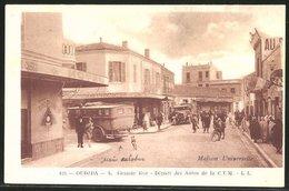 CPA Oudjda, Grande Rue, Départ Des Automobiles De La C. T.M., Maison Universelle - Non Classés