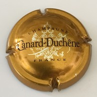 103 - Capsule De Champagne - 75g - Canard-Duchêne, Bronze (petites Lettres) - Canard Duchêne