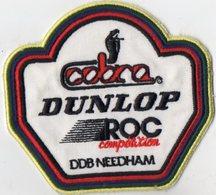 E17 - Sport Automobile - Ecusson 12 X 11 - COBRA - DUNLOP - ROC Compétition - DDB NEEDHAM - Ecussons Tissu