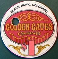 $1 Casino Chip. Golden Gates, Black Hawk, CO. Drilled. M88. - Casino