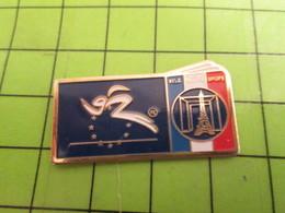 210a Pin's Pins / Beau Et Rare : Thème SPORTS : VISA POUR L'EUROPE TOUR EIFFEL ARCHE DE LA DEFENSE - Badges