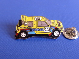 Pin's Démons Et Merveilles - Voiture Peugeot 205 Rallye Paris Dakar 1990 - Camel Michelin Esso (EA1) - Rallye