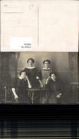 580816,Gruppenbild Vier Frauen B. Tisch Buch - Ansichtskarten