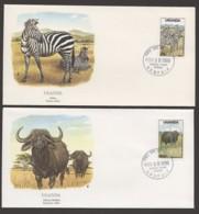 1988  National Parks - Zebras 25/-, African Buffalos 100/-  Unadressed FDCs - Ouganda (1962-...)