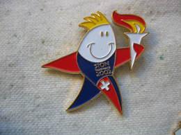 Pin's Des Jeux Olympiques De SION En 2002 (Valais Suisse). Flamme Olympique - Jeux Olympiques
