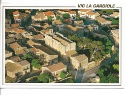 34 VIC LA GARDIOLE : L 'Eglise Fortifiée XIIème Siècle / CPM E.M. Voyagée 1994 / TBE - Other Municipalities