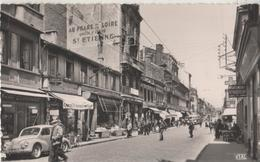 CPSM 42. Firminy. Rue Principale, Rue Jean Jaurès. Magasins; Renault 4CV - Firminy