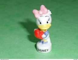 Fèves / Disney : Daisy Ou Zaza     T32 - Disney