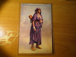 CARTOLINA TUNIS  BEDUINE PORTANT SON ENFANT    - D 2863 - Tunisia