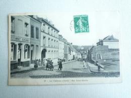 1910 LE CATEAU RUE SAINT MARTIN   EDITION BF CIRCULÉE DOS DIVISE  ETAT BON - Le Cateau