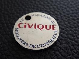 JETON CADDIE CADDY METAL - CIVIQUE - LE MAGAZINE DU MINISTERE DE L'INTERIEUR - PRESSE - Trolley Token/Shopping Trolley Chip