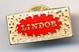 "(12562) Pin's "" Lindor "". TBE.  "" En Baisse "" - Food"