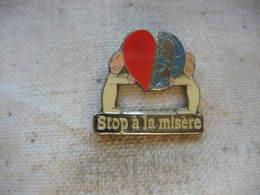 """Pin's """"STOP à La Misère Dans Le Monde"""" - Pin's"""