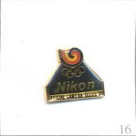 Pin's Sport - J.O De Séoul 1988 - Sponsor Nikon. Estampillé ©️ 1983 Slooc TM. Epoxy. T622-16 - Photography