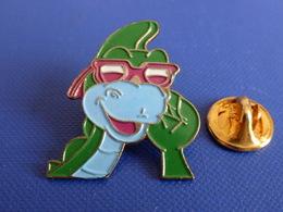 Pin's Dinosaure Denver - FR3 - Dessin Animé - Lunettes (RA31) - Medias