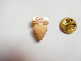 Beau Pin's , Lledo , Fabricant D'appareils D' éclairage , Gennevilliers - Pin's