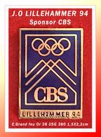 """SUPER PIN'S JEUX OLYMPIQUES 94 : Sponsor """"CBS"""" Aux J.O. De LILLEHAMMER (Norvège), émail Grand Feu Base Or, 1,5X2,2cm - Jeux Olympiques"""