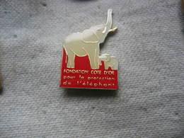 """Pin's De La Fondation """"cote D'or"""" Pour La Protection De L'elephant. (Chocolat Cote D'or) - Animaux"""