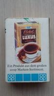 Zündholzschachtel Mit Einer Kaffee-Packung (COOP) Aus Deutschland - Zündholzschachteln