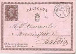 """CARTOLINA POSTALE,RISPOSTA,EFFIGIE V.E.II BRUNO SU ROSA ANNULLATO CON BOLLO """"MILANO-STAZ. 30-NOV-75-9S PER BOBBIO. - 1861-78 Victor Emmanuel II."""