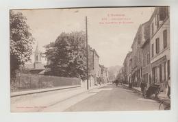 CPSM DECAZEVILLE (Aveyron) - Rue Gambetta Et Clocher - Decazeville