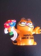 "Garfield  ""have A Nice Day"",fleurs, - Figurines"