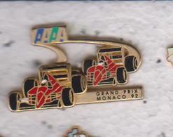 Pin's  GRAND PRIX DE MONACO 92    FERRARI DOUBE MOULES SIGNEE ARTHUS BERTRAND - Ferrari
