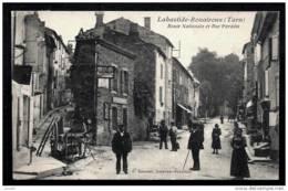 CPA ANCIENNE FRANCE- LABASTIDE-ROUAIROUX (81)- ROUTE NATIONALE ET RUE PARADIS- BELLE ANIMATION GROS PLAN- CHARRETTES - Frankreich