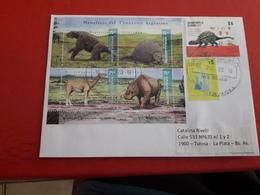 L'Argentine Enveloppe Circulé Avec Timbres Et Bloc Des Dinosaures - Argentinië