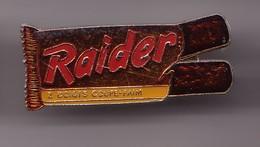 Pin's Raider 2 Doigts Coupe Faim Barre De Céréales Chocolatée Réf 1264 - Alimentación