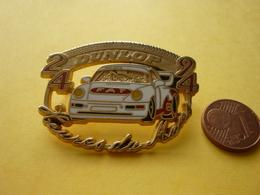 Pin's Porsche   DUNLOP 24 HEURES DU MANS  Signe Locomobille (94) - Porsche