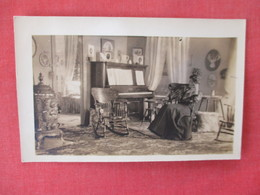 RPPC Piano In Living With Lady      Ref. 3084 - To Identify
