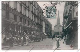 CPA Animée PARIS XVeme : Rue Du Commerce - Eglise Saint Jean Baptiste De Grenelle (commerce Tapis Habits) - Arrondissement: 15