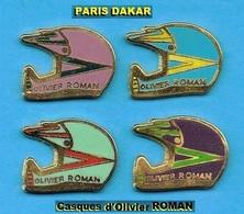 4 PIN'S //  ** CASQUES / PILOTE DU PARIS DAKAR / Olivier ROMAN / HYERES ** . (4 Couleurs Différentes ) - Badges