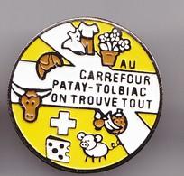 Pin's Au Carrefour Patay Tolbiac On Trouve Tout  Réf 7373JL - Cities