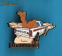 1 PIN'S //    ** TOYOTA / HILUX 4 X 2 ** . (Arthus Bertrand) - Toyota