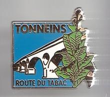 Pin's Tonnens Route Du Tabac  Pont Feuille De Tabac Réf  2170 - Cities