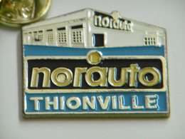 Pin's - Garage Automobile NORAUTO à THIONVILLE 57 MOSELLE - Badges