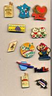 Lot 12  Pin's   à Voir - Badges