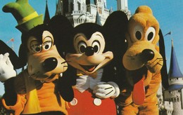 Goofy, Mickey Mouse And Pluto Greet Magic Kingdom Guests With Hearty Handshakes And Hugs Galore. - Disneyworld