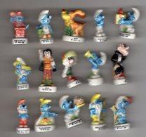 TRES RARE Série Complète 16 Fèves Brillantes Les Schtroumpfs SCHTROUMPFANIE 1995 Différente De Celles De 1996 Et De 1997 - Cartoons