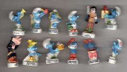 Série12/16 Fèves Brillantes SCHTROUMPFANIE 1996 Les Schtroumpfs Différente De Celles De 1995 Et De 1997 - Cartoons