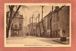 CPA - SAINT-JEAN-du-BRUEL (12) - Aspect De La Grande Rue Dans Les Années 20 / 30 - Otros Municipios