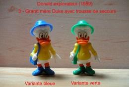 "Kinder 1989 : 2 Variantes : Grand-mère Duke Avec Trousse & Tenue Jaune/bleue - Tenue Jaune /verte ""Donald Explorateur"" - Cartoons"