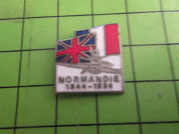 1417 Pin's Pins /  Belle Qualité Et Rare / THEME MILITARIA : D-DAY NORMANDIE 1944 HAWKER TYPHOON DRAPEAUX F GB - Army